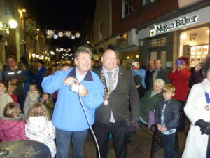 Photograph shows Alan Titchmarsh MBE turning on the town's festive lights, with the Mayor of Cowes