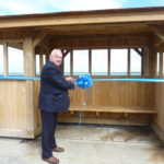 Photograph shows former Mayor of Cowes, Geoff Banks BEM unveiling the seafront shelter