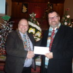 Photograph of the Mayor of Cowes presenting a donation to the Earl Mountbatten Hospice