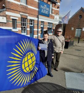 Mayor of Cowes, Lora Peacey Wilcox and Councillor Paul Taylor raised the Commonwealth Flag at Francki Place, Cowes