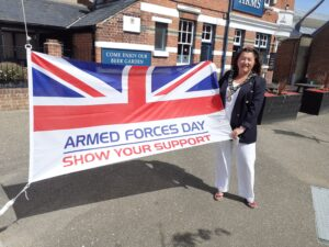 Mayor of Cowes photographed with Armed Forces Day flag