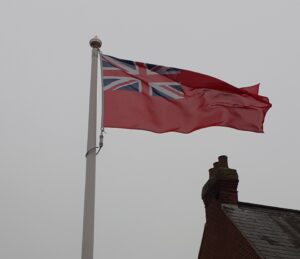 Photo of Red Ensign flag flying to commemorate Merchant Navy Day 2020.